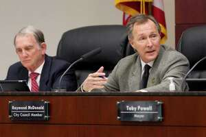 Conroe Councilmen Seth Gibson, left, and Raymond McDonald, right, worked with city to staff to mitigate a sewer rate hike for residents.