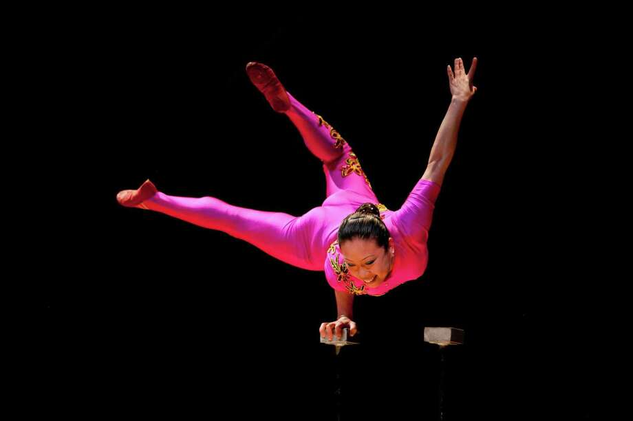 "Chinese acrobat Li Liu will perform during a day-long international ""Take Your Child to Library Day"" celebration at the Pequot Library in Fairfield's Southport section on Feb. 2. Photo: Pequot Library / Contributed Photo / Connecticut Post Contributed"