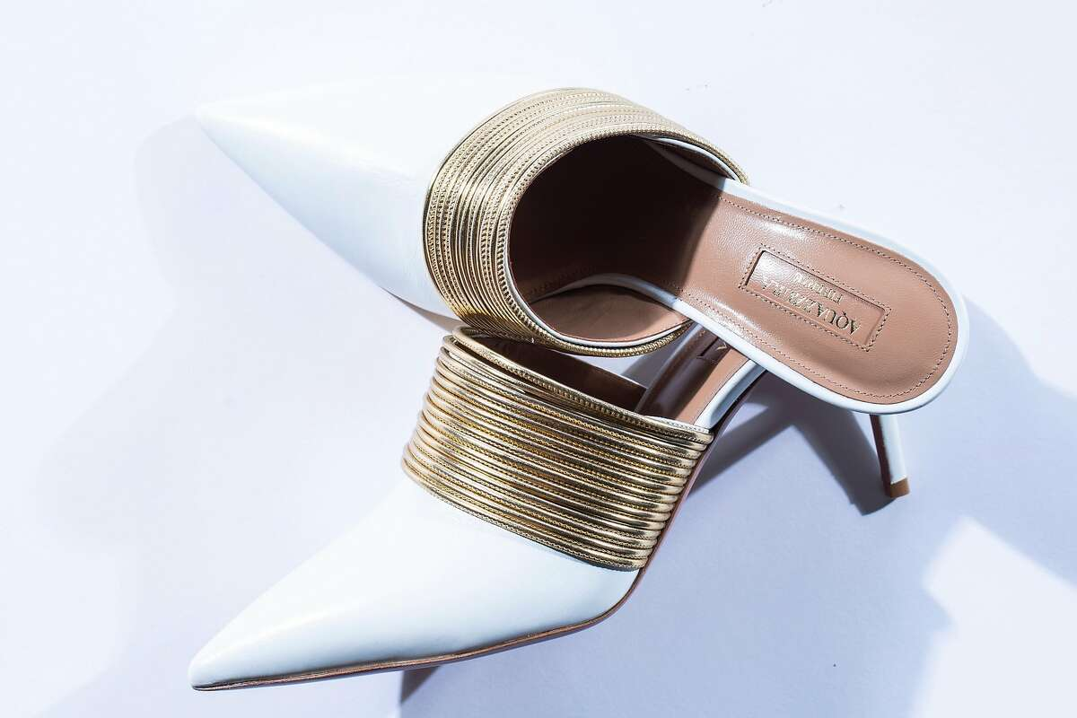 Aquazzura's sleek Rende Vous white and gold mules ($750) from Saks Fifth Avenue.