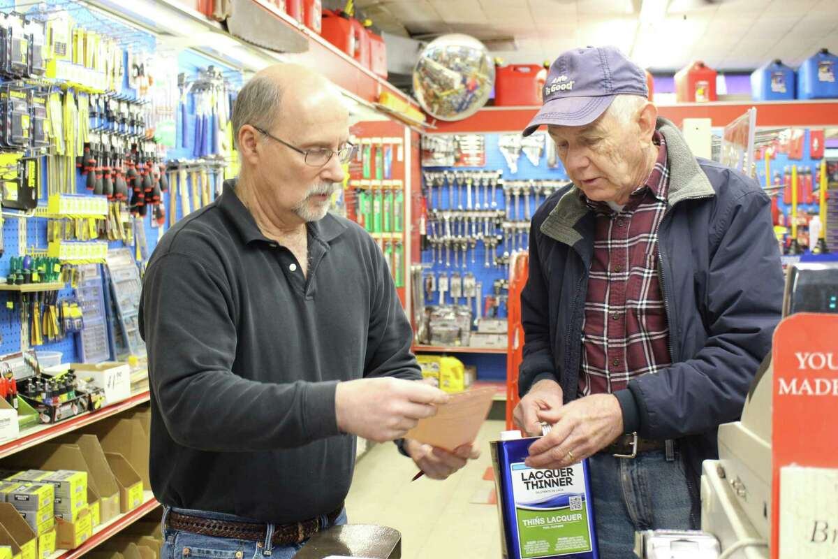 Owner David Otto, left, assists long time customer Ron Jones with his final purchase as Stepney prepares to close for good.