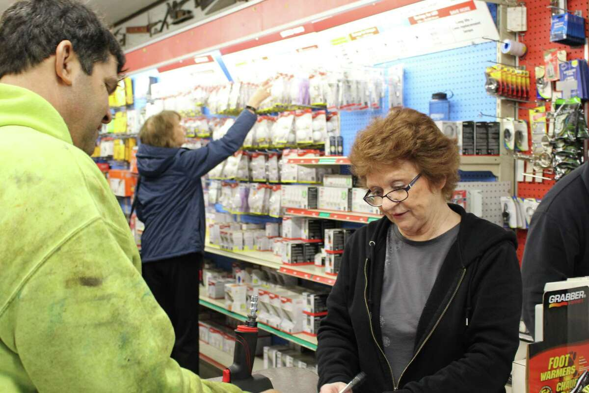 Customers make their final purchases at Stepney Hardware in Monroe which is closing for good.