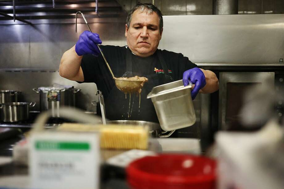 Gary Armendarez, head chef for The Whole Enchilada, a Mexican restaurant in Bay City, prepares food on Thursday, Jan. 24, 2019 inside the restaurant's new location at 310 E. Midland Street. (Katy Kildee/kkildee@mdn.net) Photo: (Katy Kildee/kkildee@mdn.net)