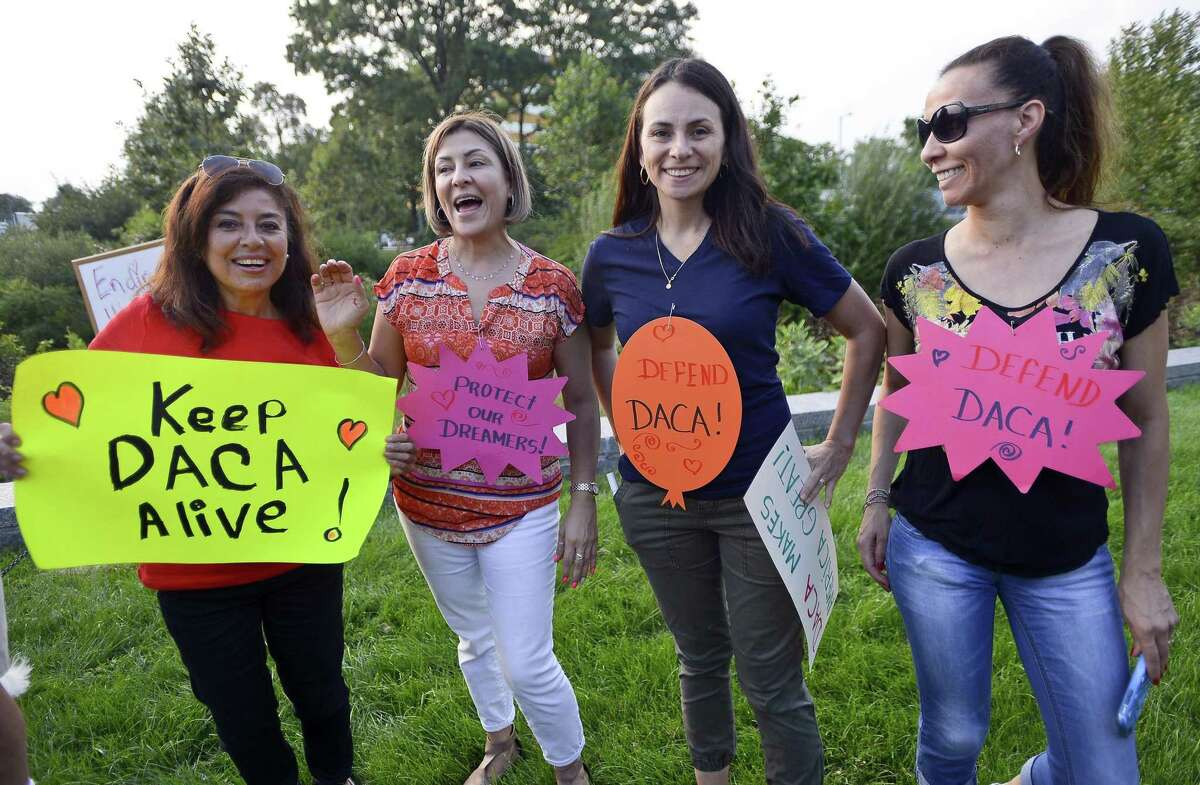 From left, Miriam Matos of Stamford, Maria Valderrama, Totiona Mendoza and Andrea Vanegas, all of Norwalk show their support as spearkers address hundreds of activists from Fairfield County communities gathered in Mill River Park, across from Trump Parc Stamford in Stamford, Connecticut on Tuesday, Sept. 5, 2017. The group was protesting President Donald Trump action on the future of Deferred Action for Childhood Arrivals (DACA). Without DACA, 800,000 immigrant youth and their families who have made this country their home will their protection from deportation.