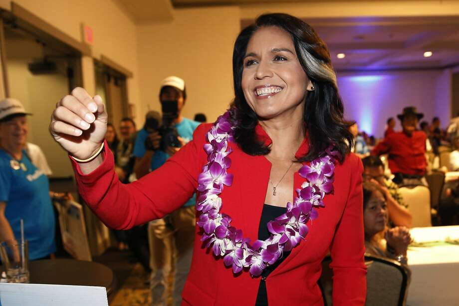 Rep. Tulsi Gabbard, 37, has represented Honolulu's suburbs and rural Hawaii in the U.S. House since 2013. She is a combat veteran who served in Iraq and Kuwait with the National Guard. Photo: Marco Garcia / Associated Press 2018