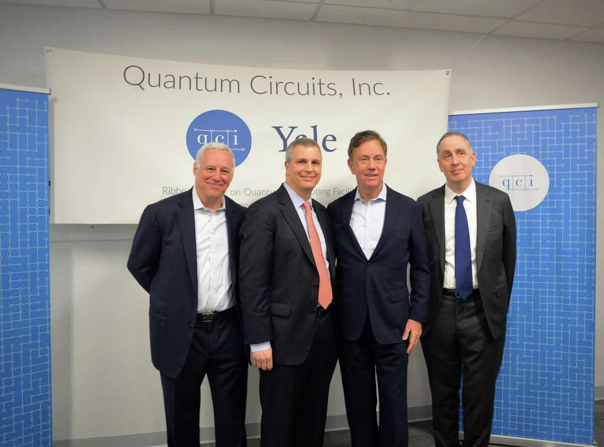 From left, Dan Ciporin, Robert Schoelkopf, Gov. Ned Lamont and Peter Schiffer attend a ribbon-cutting ceremony for Quantum Circuits Thursday in New Haven.