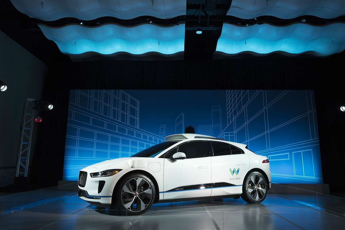 """FILE - In this March 27, 2018 file photo, the Jaguar I-Pace vehicle outfitted with Waymo's suite of sensors and radar is introduced in New York. Google's self-driving car spinoff Waymo said Tuesday it will bring a factory to Michigan, creating up to 400 jobs at what it describes as the world's first plant """"100 percent"""" dedicated to the mass production of autonomous vehicles. (AP Photo/Mark Lennihan, File)"""