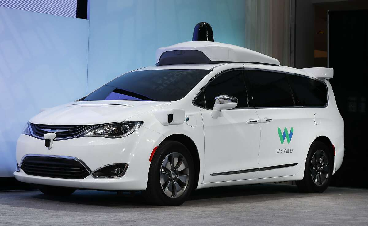 """FILE - In this Jan. 8, 2017, file photo a Chrysler Pacifica hybrid outfitted with Waymo's suite of sensors and radar is displayed at the North American International Auto Show in Detroit. Google's self-driving car spinoff Waymo said Tuesday it will bring a factory to Michigan, creating up to 400 jobs at what it describes as the world's first plant """"100 percent"""" dedicated to the mass production of autonomous vehicles. (AP Photo/Paul Sancya, File)"""