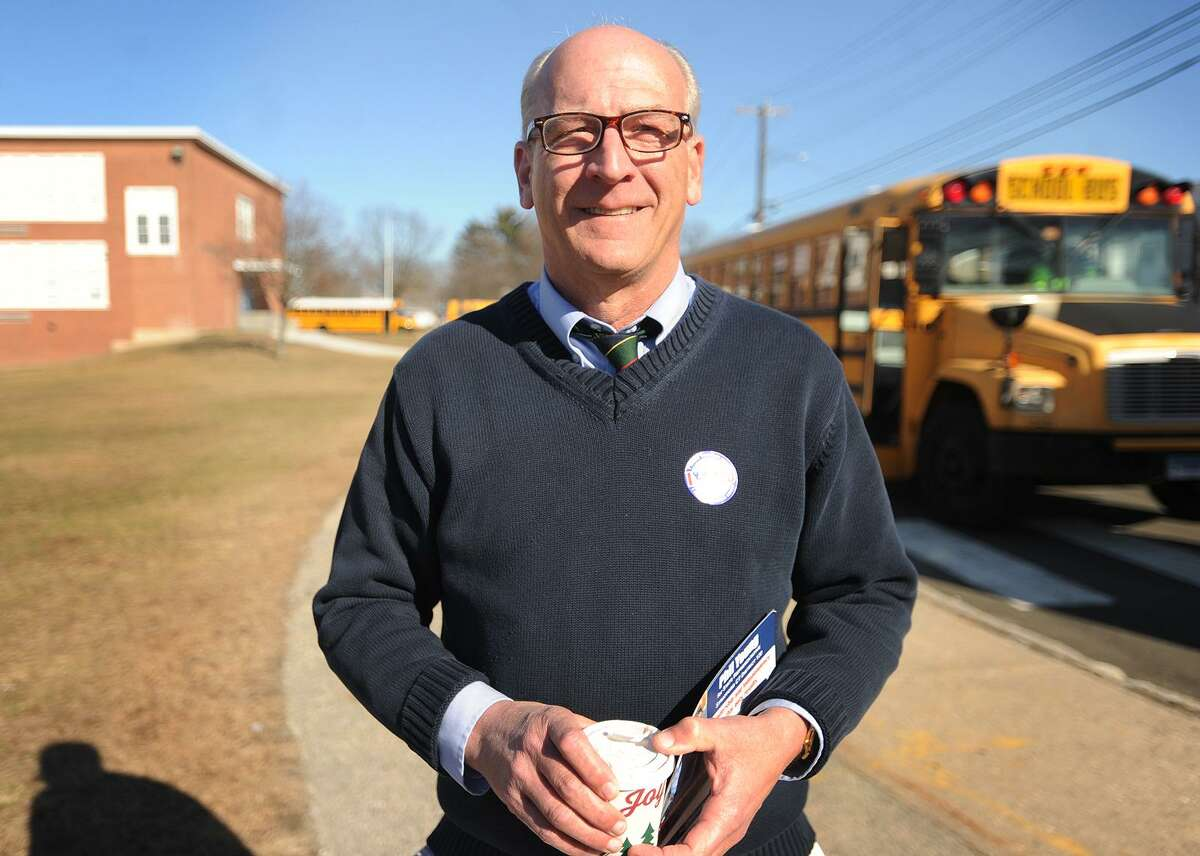 Democratic candidate for state representative for the 120th District Phil Young campaigns outside the polls at Wooster Middle School in Stratford, Conn. on Tuesday, February 27, 2018.