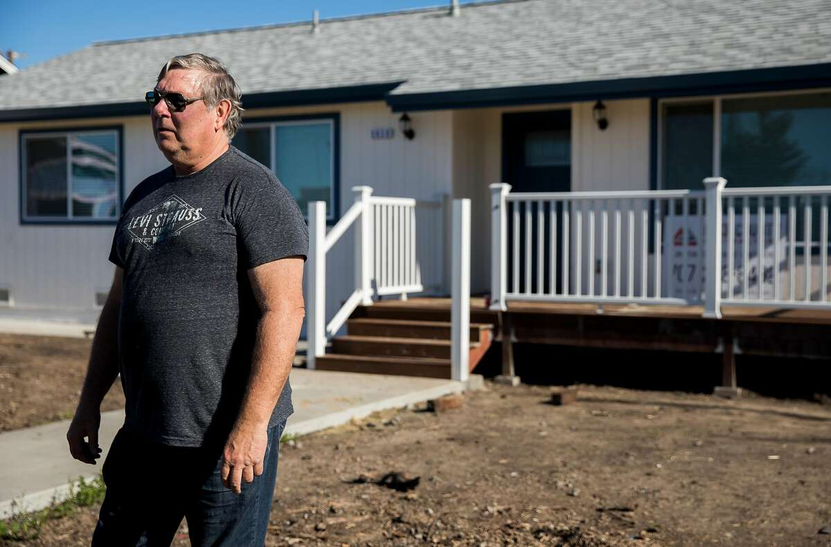 Coffey Park homeowner Lenny Briese stands outside his newly-constructed home along Coffey Lane in the Coffey Park neighborhood of Santa Rosa, Calif. Thursday, Jan. 24, 2019.