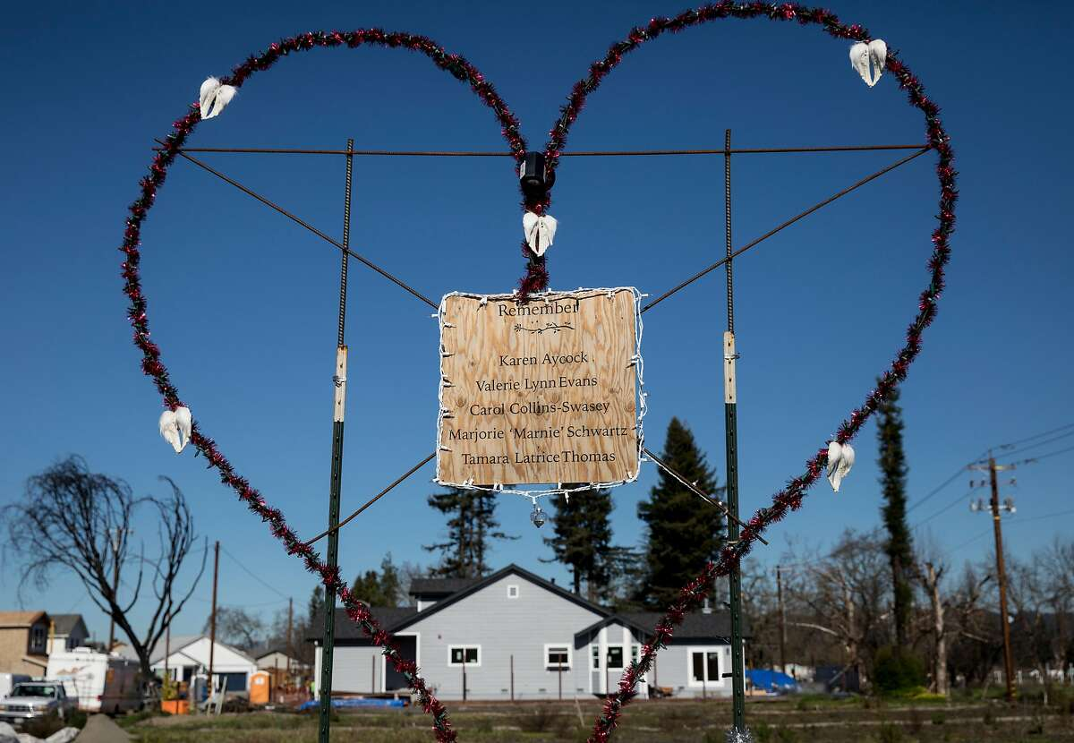 The names of those who died in the Coffey Park neighborhood during the Tubbs Fire are posted in the middle of a large heart near Hopper Avenue in Santa Rosa, Calif. Thursday, Jan. 24, 2019.