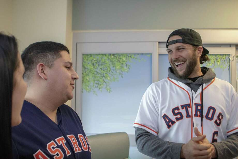 Houston Astros outfielder Jake Marisnick shares a laugh with Thomas and Holly Tristan as part of the Astros Caravan on Thursday, Jan. 24, 2019 at Houston Methodist The Woodlands Hospital in The Woodlands. Photo: Cody Bahn, Houston Chronicle / Staff Photographer / © 2018 Houston Chronicle