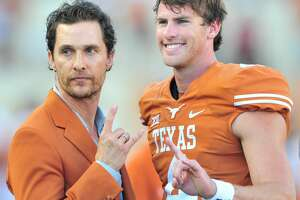 AUSTIN, TX - OCTOBER 18:  Matthew McConaughey poses for a photo with William Russ #4 of the Texas Longhorns before kickoff against the Iowa State Cyclones on October 18, 2014 at Darrell K Royal-Texas Memorial Stadium in Austin, Texas.  (Photo by Cooper Neill/Getty Images)