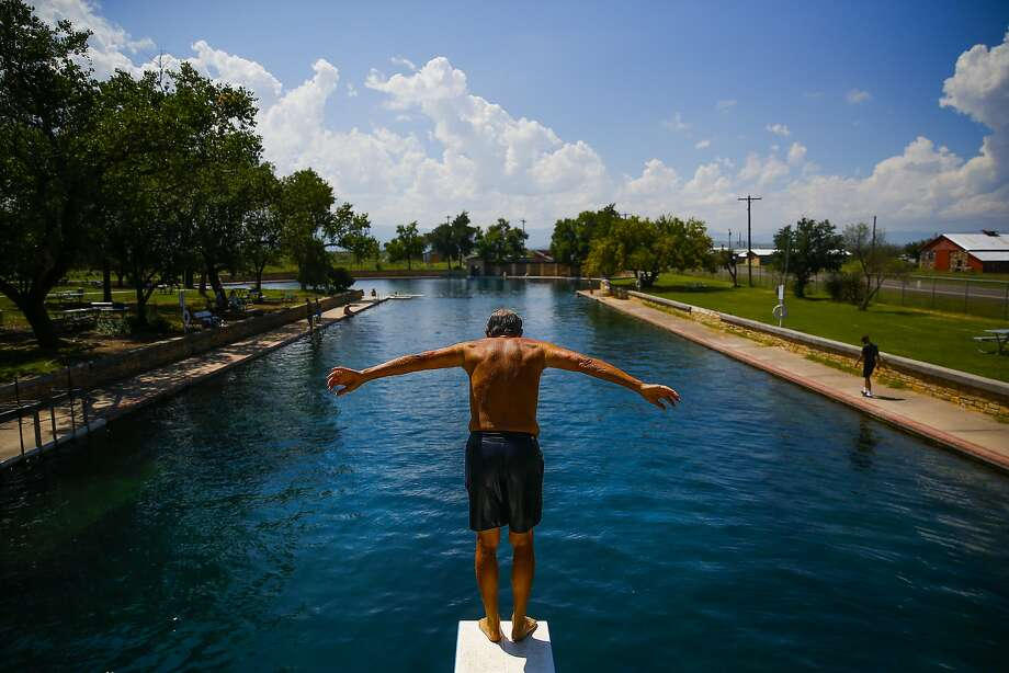 Doug Witkowski, from Dripping Springs, prepares to dive into the crystal clear waters of the worlds largest spring-fed swimming pool at Balmorhea State Park Friday, Sept. 16, 2016 four miles west of Balmorhea in Toyahvale, TX.Balmorhea State Park will be expanded after a 643-acre land acquisition recently was completed by the Texas Parks and Wildlife Department. Photo: Michael Ciaglo, Houston Chronicle