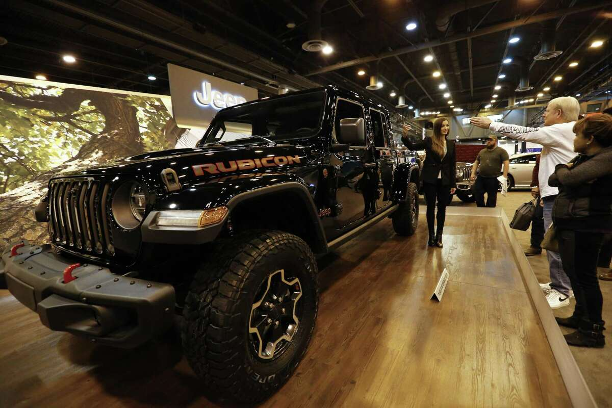 Jeep narrator Emily answers questions regarding to the 2020 Jeep Gladiator at the Houston Auto Show on Thursday, Jan. 24, 2019, in Houston. There will be four models of the Jeep Gladiator when it hits the market.