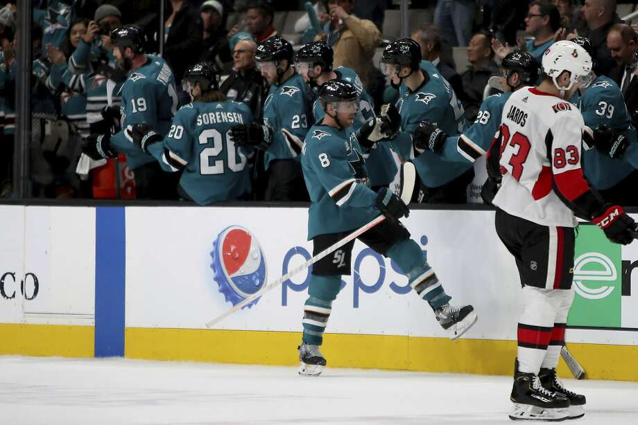 San Jose Sharks center Joe Pavelski (8) is congratulated after a second-period goal against the Ottawa Senators in an NHL hockey game in San Jose, Calif., Saturday, Jan. 12, 2019. (AP Photo/Scot Tucker) Photo: Scot Tucker / Associated Press