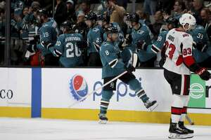 San Jose Sharks center Joe Pavelski (8) is congratulated after a second-period goal against the Ottawa Senators in an NHL hockey game in San Jose, Calif., Saturday, Jan. 12, 2019. (AP Photo/Scot Tucker)