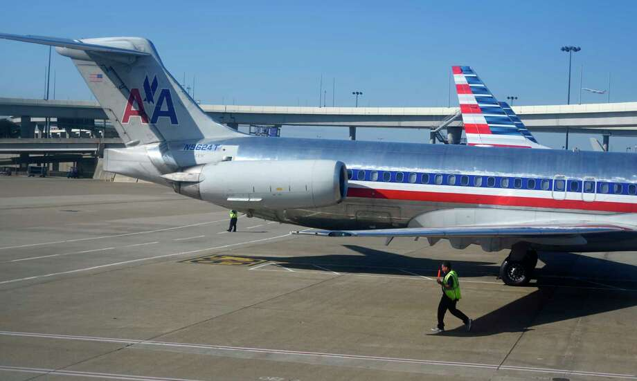 FILE- In this Nov. 5, 2018, file photo American Airlines aircraft are serviced at Dallas/Fort Worth International Airport, in Texas. Photo: Mike Stewart / Copyright 2018 The Associated Press. All rights reserved.