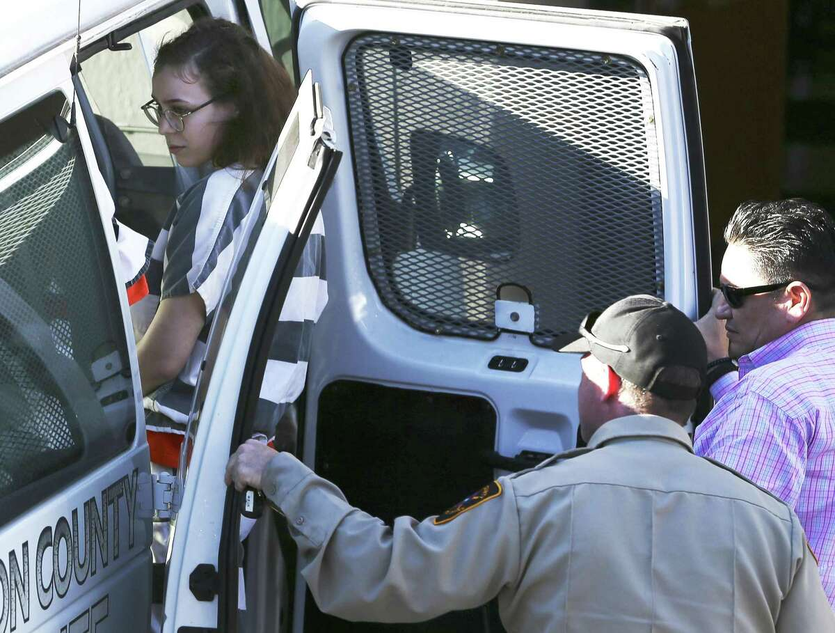 Gabriella Fritz, leaving the federal courthouse under custody, is one of two women accused of spray-painting graffiti on the San Antonio missions who appeared before federal court to plead guilty on Thursday, Jan. 24, 2019. Fritz and Sydney Elizabeth Farris have signed plea deals, while a third suspect is to plead guilty next week. They allegedly spray painted several things, including