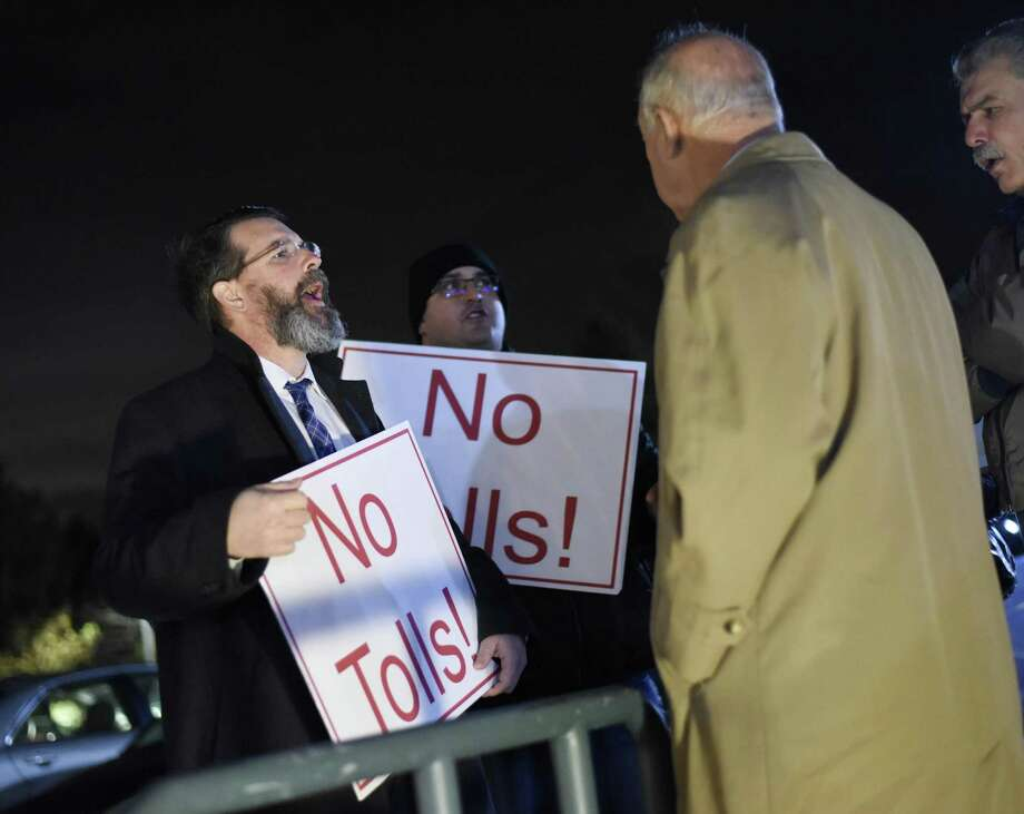 Cos Cob's Lindy Urso, left, and Greenwich's Frank Cortese protest the proposal of tolls with folks entering the Community Conversation featuring State Sen. Alex Bergstein and PepsiCo Chairman Indra Nooyi at Greenwich Library's Cole Auditorium in Greenwich, Conn. Thursday, Jan. 24, 2019. State Sen. Bergstein and Nooyi discussed how to attract and retain businesses in Connecticut as a small group protested the proposal of tolls outside the event. Photo: Tyler Sizemore / Hearst Connecticut Media / Greenwich Time
