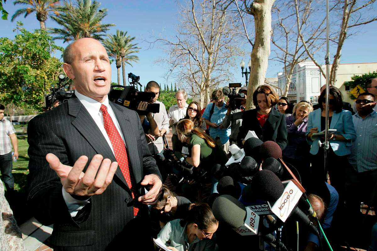 Former Orange County Sheriff Mike Carona speaks at a news conference outside court in Santa Ana, Calif., Friday, Jan. 16, 2009. A jury stunned a courtroom Friday by acquitting Carona of a sweeping corruption conspiracy and all but one related count of witness tampering in a case that alleged extensive bribery in exchange for the power of his office. (AP Photo/Nick Ut)