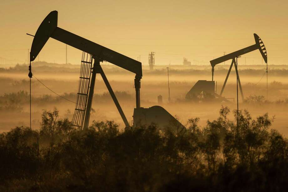 Fog blankets a low-lying area where pumpjacks operate in West Texas, northeast of Kermit, on Sept. 12, 2018. CONTINUE to see how much money area energy companies made (or lost) in recent quarterly earnings reports. Photo: Jerod Foster, HONS / Associated Press / Jerod Foster