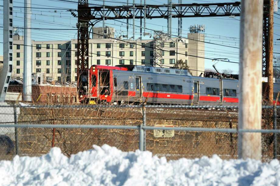 A Metro-North train passes through Bridgeport, Conn. Jan. 5, 2018, near the site of the proposed train station for the city's East Side. Photo: Ned Gerard / Hearst Connecticut Media / Connecticut Post