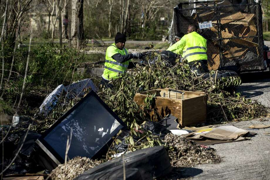Lloyd Brewster and Anthony McDonald pick up illegally dumped garbage in the Settegast neighborhood on Thursday, Jan. 24, 2019, in Houston. Settegast is among the neighborhoods just north of I-610 where development is beginning to proceed at breakneck pace as region's population, incomes and demand for housing increase. Photo: Brett Coomer, Houston Chronicle / Staff Photographer / © 2019 Houston Chronicle