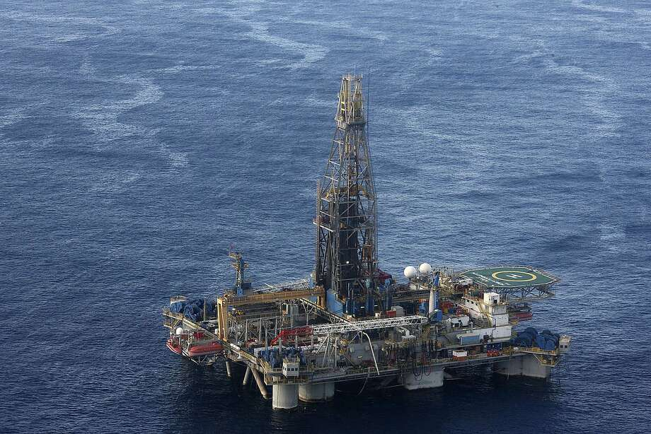 FILE - In this Monday Nov. 21, 2011 file photo, provided by the Cyprus Press and Information office, the Noble Energy company's offshore oil and gas rig is seen some 115 miles (185 kilometers) off Cyprus' south coast. Photo: Associated Press