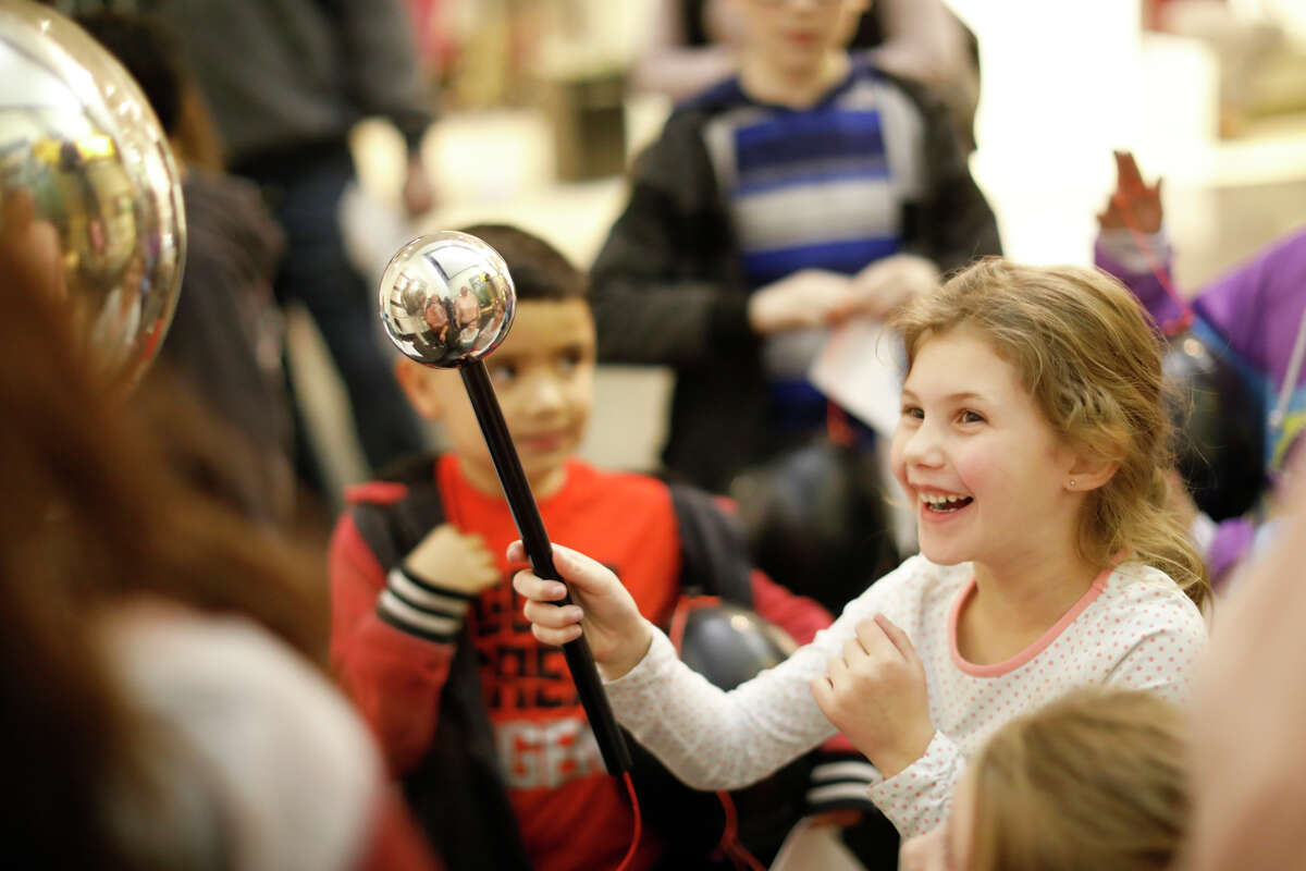 Kobi Akin reacts to a static electricity shock during Family Science Night from the Petroleum Museum in this 2019 picture. Reporter-Telegram