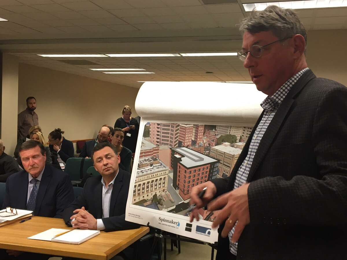 Architect Bob Tierney shows the City Plan Commission a rendering of the Hilton Garden Inn hotel approved for the corner of Elm and Orange streets.