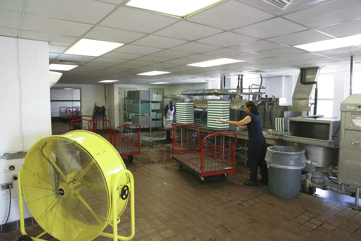 Workers prepare food on July 21, 2016, in a 1937 building which houses the main kitchens of the San Antonio State Hospital on the South Side. A structural analysis completed in 2014 found 80 percent of buildings at the hospital are in critical condition.