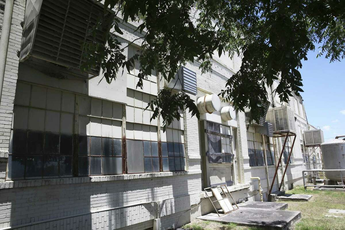 An older building, deteriorating on the outside, serves as storage at the San Antonio State hospital. A 2014 study reported 80 percent of buildings at the State Hospital in San Antonio are in critical condition.