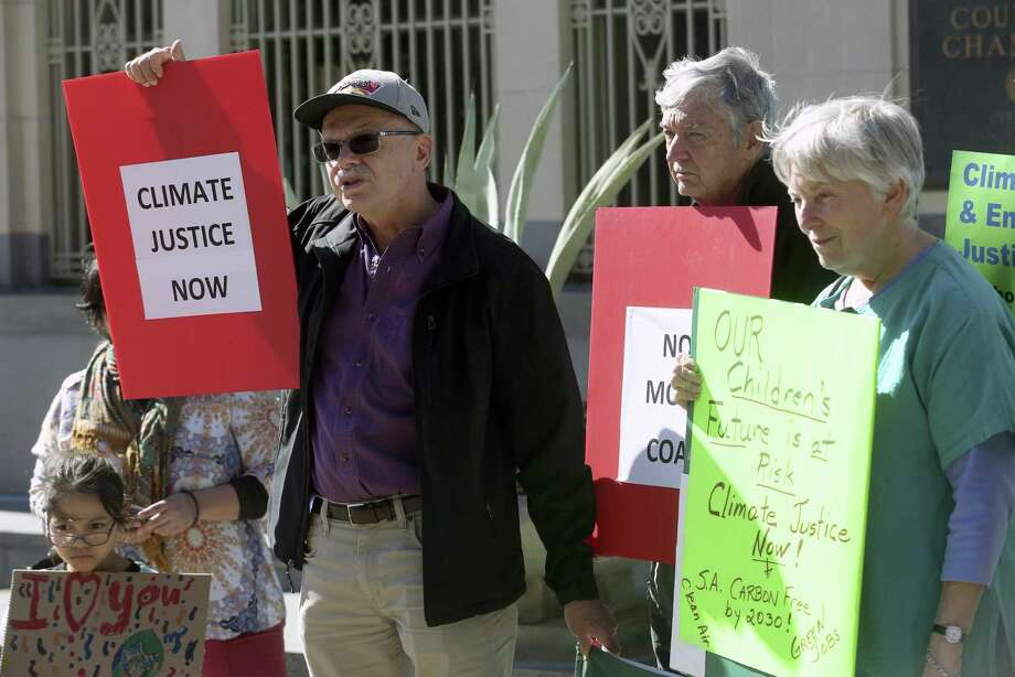 Terry Burns, chair of the local Sierra Club chapter, speaks , in front of the San Antonio council chambers in January. The cost of a climate plan ultimately depends on how much a clean environment is worth to humans. Photo: William Luther /Staff Photographer / © 2019 San Antonio Express-News