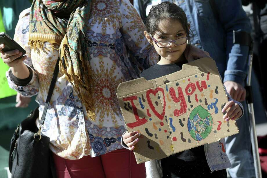 Milagro Sanchez, 7, holds a sign during a press conference Jan. 24 in front of the San Antonio council chambers where area environmental groups told what they feel the city's draft Climate Action and Adaptation Plan lacks. Photo: William Luther /San Antonio Express-News / © 2019 San Antonio Express-News