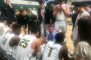 USF head coach Kyle Smith talks to his team during a first-half timeout in Thursday's game against Portland.