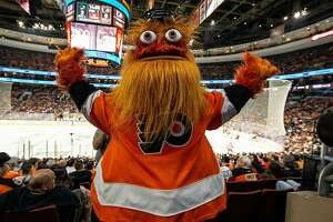 Philadelphia Flyers mascot Gritty tries to rally the crowd during a game against the San Jose Sharks at Wells Fargo Center in Philadelphia on October 9, 2018. On Saturday, Jan. 5, 2018, the Flyers dropped a 3-2 decision in overtime against the visiting Calgary Flames. (Chris Szagola/CSM/Zuma Press/TNS)