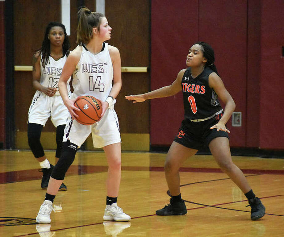 Edwardsville's Quierra Love, right, guards Belleville West's Reese Bennett during the third quarter Thursday in Belleville. Photo: Matt Kamp/Intelligencer