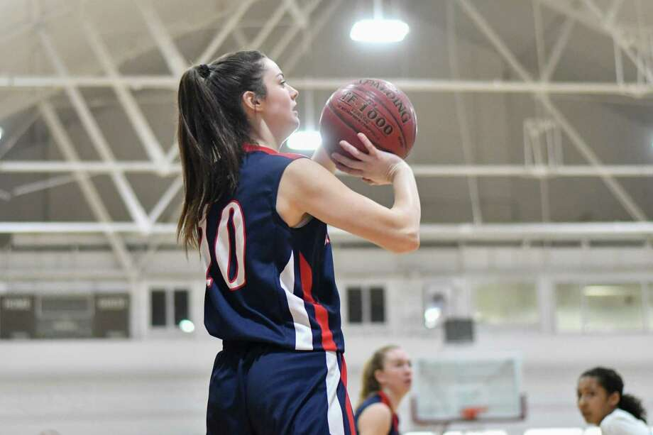 Allison Teklits (10) of the New Fairfield Rebels shoots a jump shot during a game against the Kolbe Cathedral Cougars on Thursday January 24, 2019 at The Shehan Center in Bridgeport, Connecticut. Photo: Gregory Vasil / For Hearst Connecticut Media / Connecticut Post Freelance