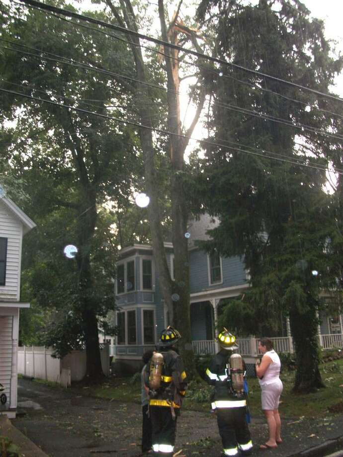 Lightning struck a tree next to 35 Mansfield Ave. Wednesday evening, shooting debris onto the yard and porch. Mansfield was closed between Sedgwick Ave. and Post Road as firefighters inspected the damage. Photo: Maggie Gordon / Darien News