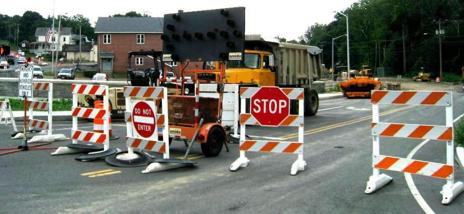 SPECTRUM/Barricades block traffic from entering what will soon be the northern end of Grove Street in New Milford, once the Grove Street/Route 67 realignment project is completed, July 19, 2010 Photo: Norm Cummings / The News-Times