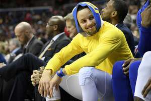 Golden State Warriors guard Stephen Curry smiles on the bench during the first half of the team's NBA basketball game against the Washington Wizards, Thursday, Jan. 24, 2019, in Washington. (AP Photo/Nick Wass)