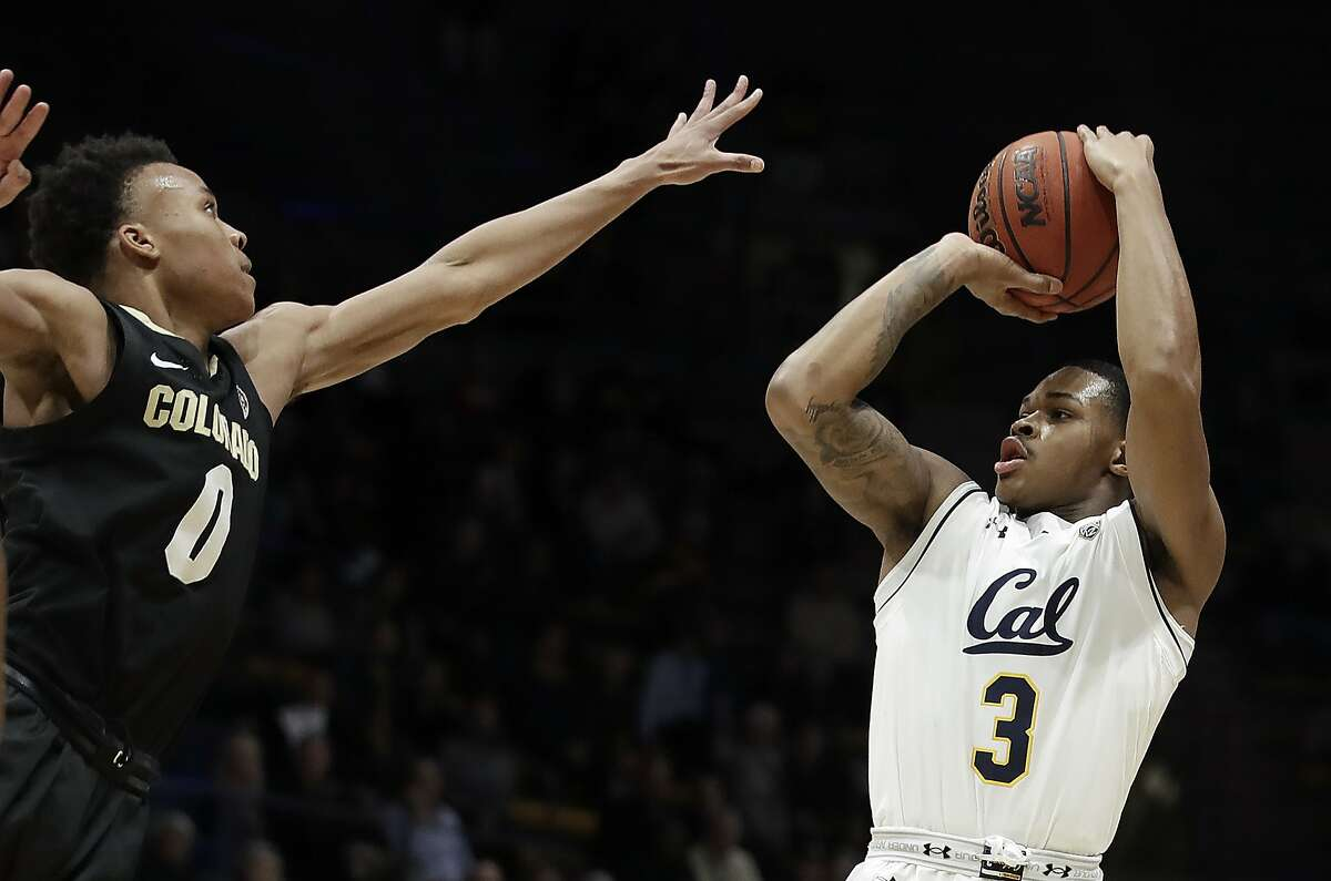 California's Paris Austin, right, shoots against Colorado's Shane Gatling (0) during the first half of an NCAA college basketball game Thursday, Jan. 24, 2019, in Berkeley, Calif. (AP Photo/Ben Margot)