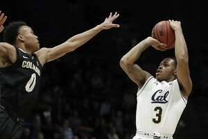 California's Paris Austin, right, shoots against Colorado's Shane Gatling (0) during the first half of an NCAA college basketball game Thursday, Jan. 24, 2019, in Berkeley, Calif. (AP Photo/Ben Margot)