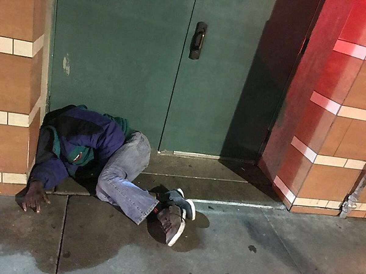 A homeless man sleeps in a Tenderloin doorway on Jan. 24, 2019, while hundreds of volunteers conduct a citywide homeless count.