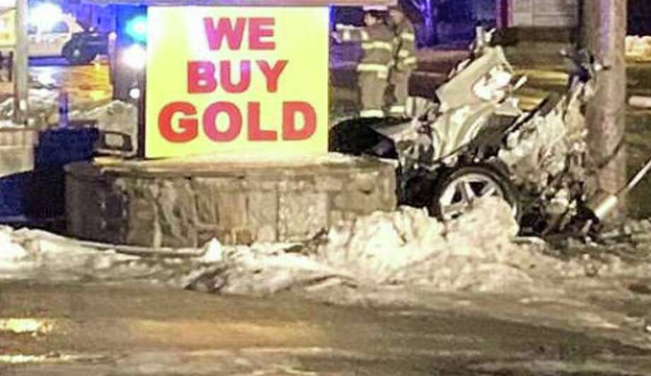 The Danbury police Traffic Division is investigating a horrific crash early Thursday, Jan. 24, 2019 that caused the driver to be ejected as the car split in two, police said. The accident occurred at around 2 a.m. as the driver was headed west on White Street, Lt. Ethan Mable said. Photo: Frederick Crowe /Contributed Photo