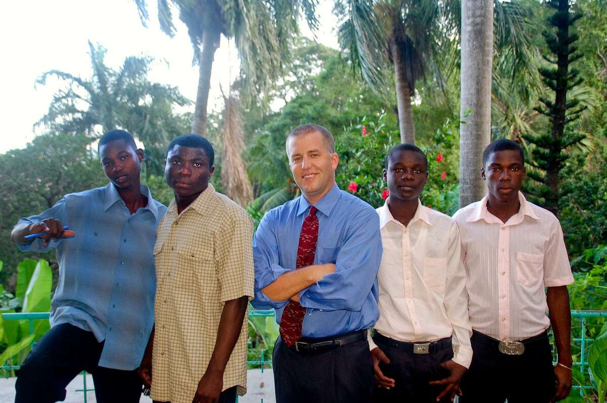 """Douglas Perlitz, center, in Haiti, at the """"Village"""" with some of the boys from the Project Pierre Toussaint."""