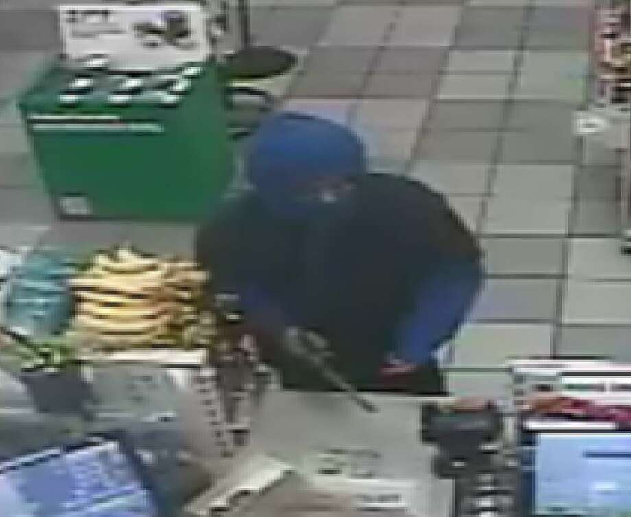 Police need help identifying the masked man accused of killing Timothy Collins, the clerk of a 7-Eleven at 7930 Callaghan Road. Photo: San Antonio Police Department
