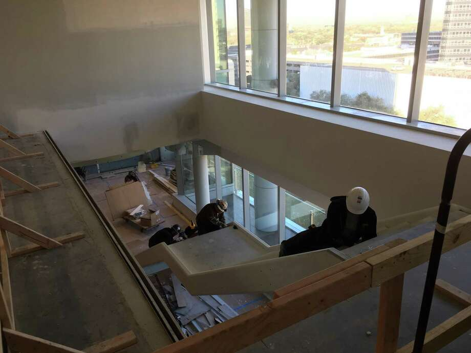 A stairwell connects the 10th and 11th floors of Firmspace's coworking suites at BBVA Compass Plaza. Members and guests in the reception area and lounge have access to conference rooms at the top of the stairs. January 10, 2019 photo. Photo: Katherine Feser / Houston Chronicle