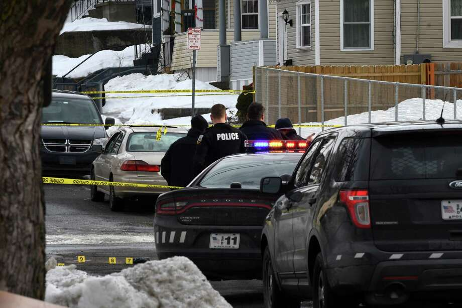 Police inspect the scene of an early morning homicide on Becker St. on Friday, Jan. 25, 2019, in Schenectady, N.Y. Roscoe Foster, 38, died at Ellis Hospital following a 1 a.m. shooting near the intersection Becker and Linden Streets. (Will Waldron/Times Union) Photo: Will Waldron, Albany Times Union