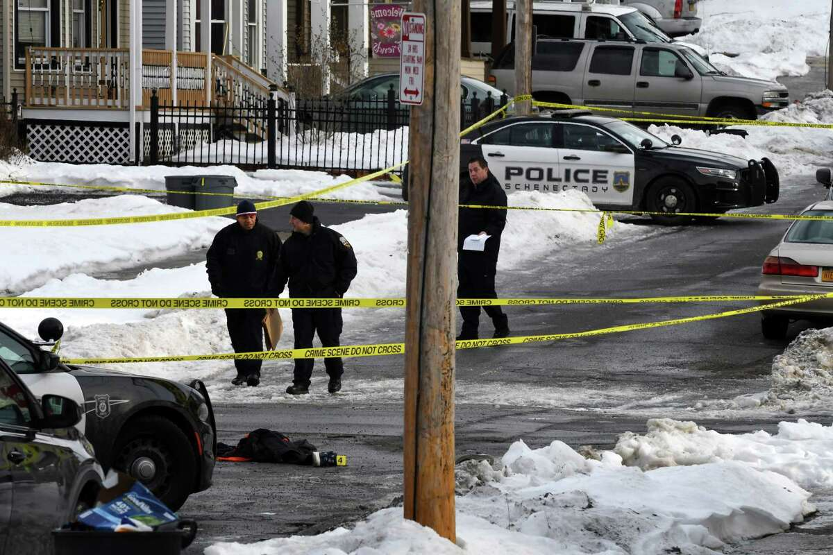 Police investigators inspect the scene of an early morning homicide on Becker St. on Friday, Jan. 25, 2019, in Schenectady, N.Y. Roscoe Foster, 38, died at Ellis Hospital following a 1 a.m. shooting near the intersection Becker and Linden Streets. (Will Waldron/Times Union)